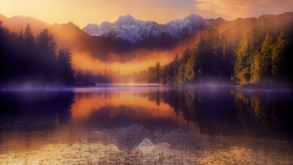 While traveling on the western coast of the southern island of New Zealand, one of my goals was to get to Matheson Lake to photograph a reflection of the two highest peaks of New Zealand, Aoraki - Mount Cook and Mount Tasman, with a height of 3,754 m and 3,498 m, respectively.<br /> <br /> In the picture, Mount Cook appears to the right and its height is visible even though it is farther than the Mount Tasman, which appears in the middle. I suffered a lot from the fluctuation of the atmosphere in my journey and I was told that the beauty of the four seasons is related there.