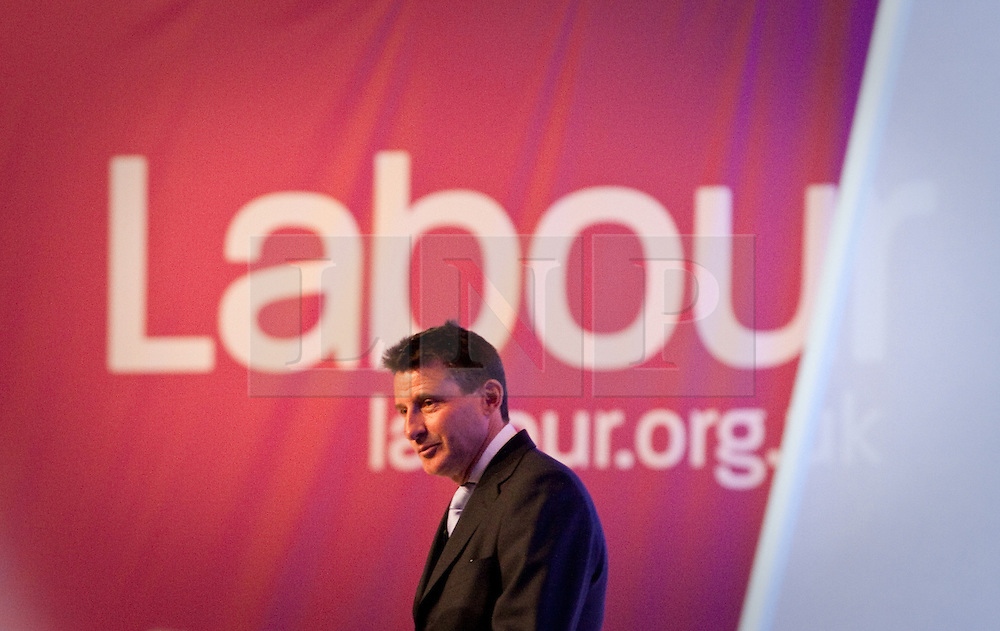 """© Licensed to London News Pictures. 02/10/2012. Manchester, UK . Sebastian Coe against a """" Labour """" backdrop on the stage during the Team Great Britain session . Labour Party Conference Day 3 at Manchester Central . Photo credit : Joel Goodman/LNP"""