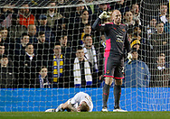Leeds United defender Liam Cooper lies injured during the EFL Sky Bet Championship match between Leeds United and Wolverhampton Wanderers at Elland Road, Leeds, England on 7 March 2018. Picture by Paul Thompson.
