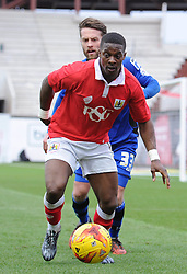 Bristol City's Kieran Agard controls the ball under pressure from Rochdale's Thomas Kennedy - Photo mandatory by-line: Dougie Allward/JMP - Mobile: 07966 386802 - 28/02/2015 - SPORT - football - Bristol - Ashton Gate - Bristol City v Rochdale AFC - Sky Bet League One
