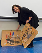"Hempstead, New York, U.S. 12th November, 2013. Janet Hamlin, a courtroom artist covering the military tribunals at Guantanamo Bay since 2006, shows her charcoal drawings and discusses her work at Hofstra University. Much of the time she was the only journalist providing a visual record of the events at the United States naval base in Cuba, and her new book ""Sketching Guantanamo"" is a collection of her images."
