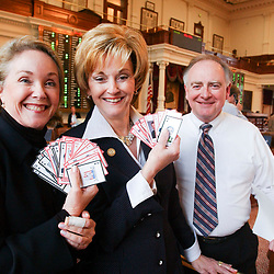 Images from 2003's Democratic walkout in the Texas House from May 12-13, 2003 during the 78th session of the Texas Legislature include Rep. Diane Delisi, R-Temple, Beverly Woolley, R-Houston, and Dan Branch, R-Canton, with Democratic playing cards.