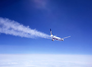Airplane contrails at high altitude