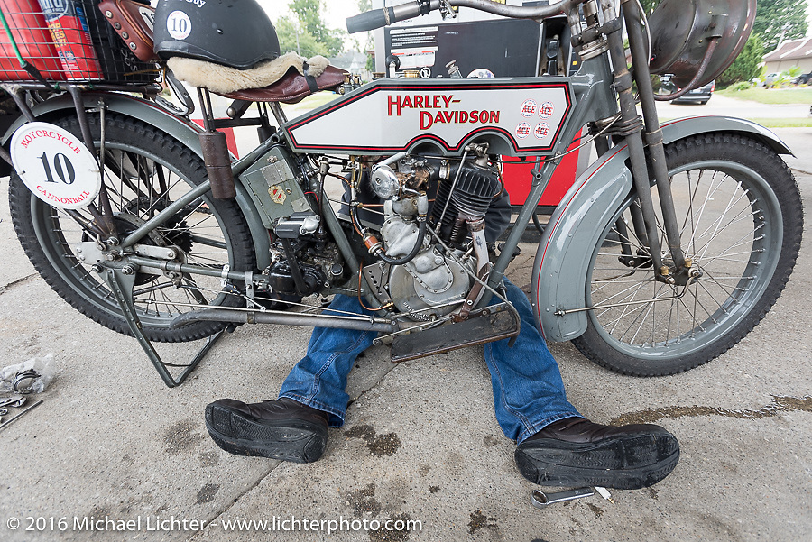 Maybe a scene out of a biker version of the Wizard of Oz? Bill Page of Kansas makes a few adjustments on his 1915 Harley-Davidson while at a gas stop during the Motorcycle Cannonball Race of the Century. Day-4 ride from Bloomington, IN to Cape Girardeau, MO. USA. Wednesday September 14, 2016. Photography ©2016 Michael Lichter.