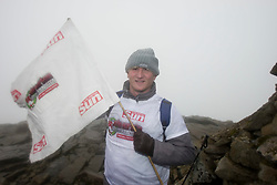 John withh the flag at the top..The John Hartson Foudation walk up Ben Nevis..Pic ©2010 Michael Schofield. All Rights Reserved.