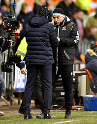 Blackpool Assistant Manager Gary Brabin (right) shakes hands with Arsenal manager Unai Emery at the end of the Emirates FA Cup, third round match at Bloomfield Road, Blackpool.