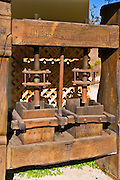 Antique wine press at Rocky Creek Cellars, Templeton, California