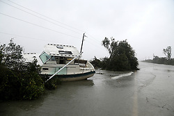October 8, 2016 - St. Augustine, Florida, U.S. - A boat (named Karma) lay on a flooded section of state road 206 which connects Crescent Beach to the mainland south of St. Augustine. The flooding was the result of hurricane Matthew passing to the east on Florida's east coast. (Credit Image: © Douglas R. Clifford/Tampa Bay Times via ZUMA Wire)