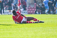 Mamadou Thiam of Barnsley (26) lays down injured during the EFL Sky Bet League 1 match between Barnsley and Coventry City at Oakwell, Barnsley, England on 30 March 2019.