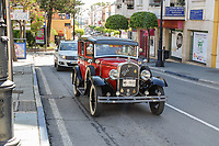 Circa 1930's Ford 8 saloon car driving through town centre, San Pedro de Alcantara, Malaga Province, Spain, 15th April 2018. Similar to car in Bonnie and Clyde movie. 201804154326.  If you can provide more information about this car please email me. Si tienes más información de este coche haga el favor de enviarme email. Gracias.<br />
