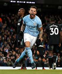 Manchester City's Nicolas Otamendi celebrates scoring his side's first goal of the game during the Premier League match at the Etihad Stadium, Manchester.