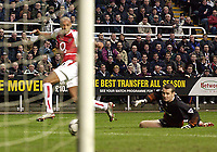 Photo. Jed Wee<br />Newcastle United v Arsenal, FA Barclaycard Premiership, St. James' Park, Newcastle. 09/02/2003.<br />Arsenal's Thierry Henry (L) and Newcastle goalkeeper Shay Given turn in unison to watch Henry's shot roll into the net.