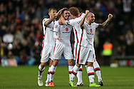 Darren Potter of MK Dons (2nd left) celebrates after scoring his sides 1st goal to make it 1-1 with Dean Lewington of MK Dons. The Emirates FA cup, 4th round match, MK Dons v Chelsea at the Stadium MK in Milton Keynes on Sunday 31st January 2016.<br /> pic by John Patrick Fletcher, Andrew Orchard sports photography.