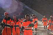 Workers in the early morning hours ending their night shift in one of the tunnels. Karahnjukar, Iceland
