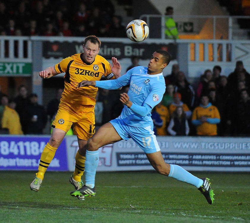 Newport County's Michael Flynn under pressure from Plymouth Argyle's Curtis Nelson<br /> <br /> Photo by Kevin Barnes/CameraSport<br /> <br /> Football - The Football League Sky Bet League Two - Newport County AFC v Plymouth Argyle - Tuesday 8th April 2014 - Rodney Parade - Newport<br /> <br /> © CameraSport - 43 Linden Ave. Countesthorpe. Leicester. England. LE8 5PG - Tel: +44 (0) 116 277 4147 - admin@camerasport.com - www.camerasport.com
