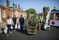 © Licensed to London News Pictures. 26/05/2018. London, UK. Members of the public carry exhibitors' plants from the 2016 Chelsea Flower show which ended today (Sat). A wide array of unusual and striking display items can be purchased on the closing day of The Royal Horticultural Society flagship flower show, held at the Royal Hospital in Chelsea since 1913. Photo credit: Ben Cawthra/LNP