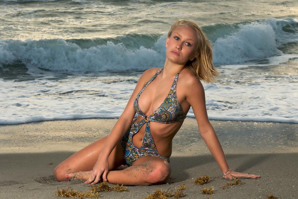 Youn caucasian blonde woman in thne beach