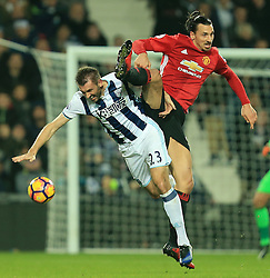 17 December 2016 - Premier League - West Bromwich Albion v Manchester United - Zlatan Ibrahimovic of Manchester United and Gareth McAuley of West Bromwich Albion battle for a header - Photo: Paul Roberts / Offside.