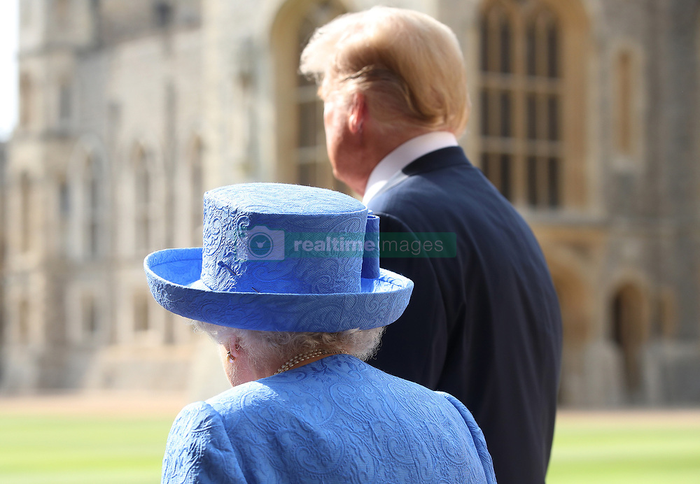 The Queen and US President Donald Trump inspect the Guard of Honour before watching the military march past at Windsor Castle, Windsor, Berkshire, UK, on the 13th July 2018. Picture by Chris Jackson/WPA-Pool. 13 Jul 2018 Pictured: Queen, Queen Elizabeth, Donald Trump. Photo credit: MEGA TheMegaAgency.com +1 888 505 6342