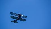 Waco YPF-6 flying over WAAAM.