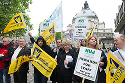 © London News Pictures. 14/05/15. London, UK. Members of the BECTU and the NUJ protest outside the ITV AGM in a dispute over pay, Queen Elizabeth II Centre, Westminster, Central London. Photo credit: Laura Lean/LNP
