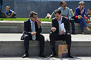 © Licensed to London News Pictures. 31/05/2013. London, UK Two men eat their lunch outside. Children and office workers enjoy the hot weather near to City Hall and Tower Bridge in London today May 31st 2013. Photo credit : Stephen Simpson/LNP