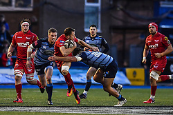 Scarlets' Tom Prydie is tackled by Cardiff Blues' Ellis Jenkins - Mandatory by-line: Craig Thomas/Replay images - 31/12/2017 - RUGBY - Cardiff Arms Park - Cardiff , Wales - Blues v Scarlets - Guinness Pro 14