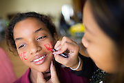 Sienna Reyes, 11, of Pomeroy has her face painted during the Jack Emery Food Drive luncheon at Milpitas Community Center in Milpitas, California, on November 4, 2014. (Stan Olszewski/SOSKIphoto)