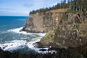 Bluffs drop sharply into the blue green Pacific Ocean immediately south of Cape Meares, on the Oregon coast, USA.
