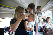 Victoria and Lee with their son Bo. They are on their way to Brighton for the day but are now stuck, hot and hungry on a broken down train. A First Capital Connect train breaks down outside London Bridge. The train and passengers are stuck for two and half hours before the passengers are transferred onto another train and taken to East Croydon. Many of the passengers are travellers heading to Gatwick Airport and they all miss their planes.