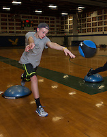 With snow still blanketing GHS fields Ethan Carrier and the  baseball team work on conditioning exercises in the gym during their Friday afternoon practice.  (Karen Bobotas/for the Laconia Daily Sun)