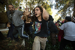 August 27, 2017 - Berkeley, California, U.S. -  A man escapes after being beaten by anti-right-wing protesters at MLK Jr. Civic Center Park on Sunday. (Credit Image: © Paul Kuroda via ZUMA Wire)