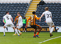 Hull City's Keane Lewis-Potter hidden by Oxford United's Anthony Forde scores his side's first goal in the 22nd minute <br /> <br /> Photographer Lee Parker/CameraSport<br /> <br /> The EFL Sky Bet League One - Hull City v Oxford United - Saturday 13th March 2021 - KCOM Stadium - Kingston upon Hull<br /> <br /> World Copyright © 2021 CameraSport. All rights reserved. 43 Linden Ave. Countesthorpe. Leicester. England. LE8 5PG - Tel: +44 (0) 116 277 4147 - admin@camerasport.com - www.camerasport.com
