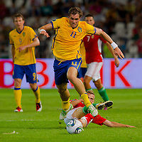 Sweden's Johan Elmander (front L) and Hungary's Vladimir Koman (bottom C) fight for the ball during the UEFA EURO 2012 Group E qualifier Hungary playing against Sweden in Budapest, Hungary on September 02, 2011. ATTILA VOLGYI