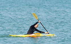 © Licensed to London News Pictures 22/07/2021. Whitstable, UK. A man canoeing along Whitstable Bay. Another hot heatwave day as people enjoy a day out at Whitstable in Kent. Photo credit:Grant Falvey/LNP