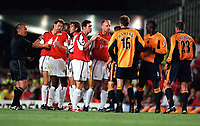 Arsenal and Liverpool players clash after a challenge by Jamie Carragher (23) on the innocent Patrick Vieira, referee Graham Poll doesn't help matters. Arsenal 2:0 Liverpool, F.A.Carling Premiership, 21/8/2000. Credit : Colorsport / Stuart MacFarlane.