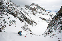 Jackson Hole Mountain Guide Doug Workman skis into the Red Sentinel Couloir, Grand Teton National Park, Wyoming.