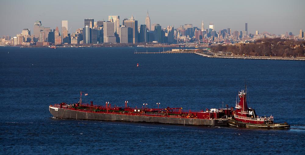 Ships in New York harbor offloading their cargo.