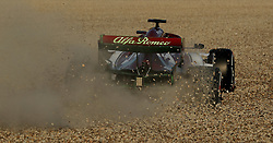 Kimi Raikkonen spins into the gravel on his opening lap in the Alfa Romeo during day one of pre-season testing at the Circuit de Barcelona-Catalunya.
