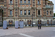 St. Petersburg, Russia -- July 20, 2019. Two Tourists Stand Outside the Ornate Church of the Spilled Blood.