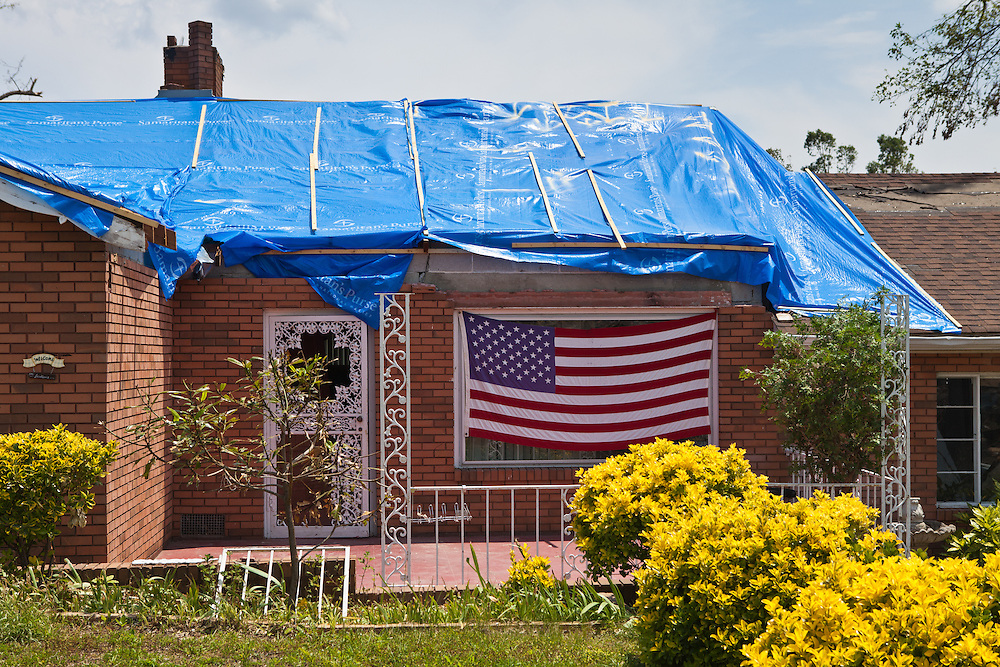 American flag in front of a home damaged by a tornado in Alabama. Pleasant Grove, a suburb of Birmingham<br />  Alabama <br /> remains in a state of ruin over two weeks after it was hit by an F-4 ( possibly an F-5) tornado, one of an estimated 300 that struck Alabama and the neighboring states on April 27th , 2011.