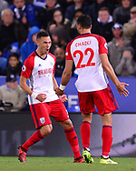Nacer Chadli of West Bromwich Albion celebrates with teammate Kieran Gibbs (l) after he scores his teams 1st goal  to make it 0-1 . .Premier league match, Leicester City v West Bromwich Albion at the King Power Stadium in Leicester, Leicestershire on Monday 16th October 2017.<br /> pic by Bradley Collyer, Andrew Orchard sports photography.