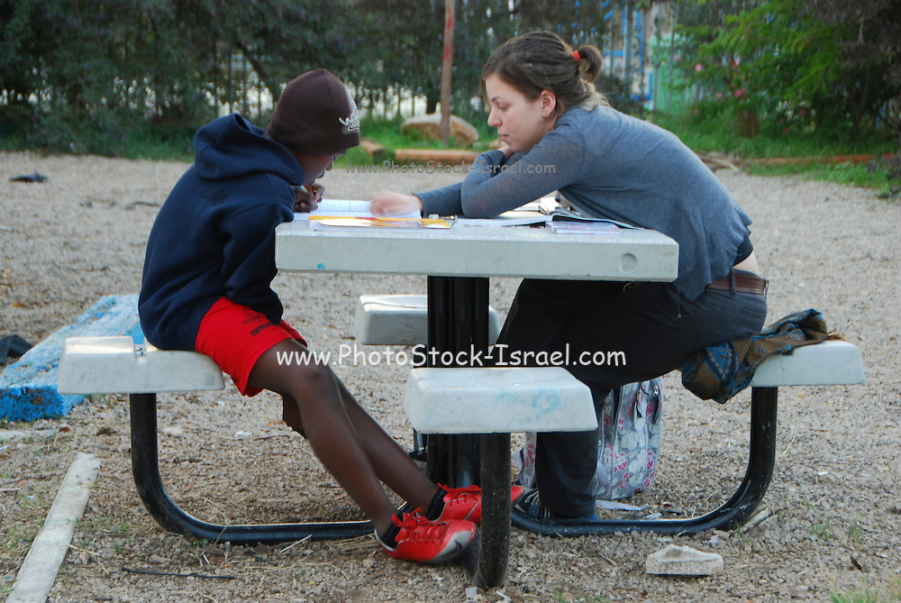 Israel, Tel Aviv, Shapira Neighbourhood, a Learning Center where local Israeli youth volunteer to help children of foreign workers with school assignments