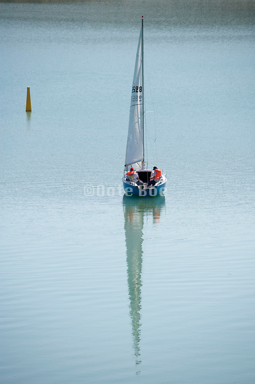two men in a recreational sailboat
