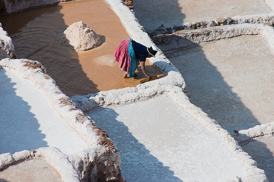 A woman works in her plot at the Salinas salt pans of Maras, Sacred Valley, Peru on September 22, 2005. Natives of Maras own and harvest the salt pans for sale to the cooperative which distributes it to the region's markets as industrial to table salt.