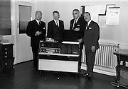 30/7/1964<br /> 7/30/1964<br /> 30 July 1964<br /> <br /> Mr. Fred Youell on the Left being presented with a Radiogram on his retirement as Depuy Chairman of Castrol(Ireland) with him from left to right are Mr. G.V. Collins Director of Castrol(Ireland) Mr. John Harding Sales Manager and Mr. L.A.C. Courtney the Managing Director or Castrol Ireland.