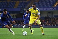 AFC Wimbledon midfielder Liam Trotter (14) taking on Faustino Anjorin of Chelsea (64) during the EFL Trophy match between U21 Chelsea and AFC Wimbledon at Stamford Bridge, London, England on 4 December 2018.