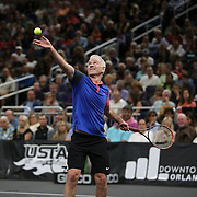 Tennis legend John McEnroe is seen as he serves the ball during the PowerShares Tennis Series event at the Amway Center on January 5, 2017 in Orlando, Florida. (Alex Menendez via AP)
