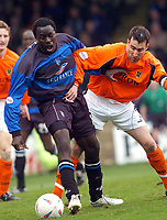 SPORTSBEAT 01494 783165<br /> PICTURE ADY KERRY .<br /> GILLINGHAM VS CARDIFF CITY<br /> GILLINGHAM'S PATRICK AGYEMANG CHALLENGES CARDIFF CITY'S TONY VIDMAR DURING THEIR PREMIERSHIP MATCH AT THE VALLEY,3RD APRIL 2004.