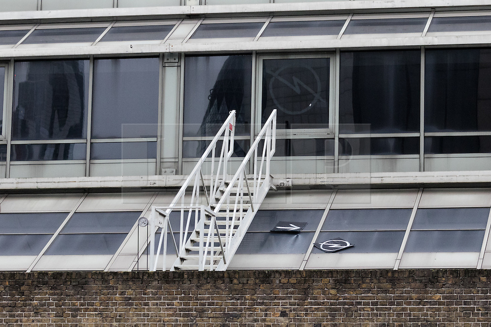 © Licensed to London News Pictures. 30/12/2015. London, UK. A marked section on the roof of the Royal Mint building where the squatters are believed to have entered and a sign for other squatters to join them.  Squatters have occupied the former Royal Mint building, located opposite the Tower of London on the border of the City of London to protest against homelessness and highlight how empty buildings could provide shelter for rough sleepers. The site was previously used to manufacture British coins but is currently vacant and activists argue that this along with other vacant commercial buildings could be used to provide short term shelter for the homeless. Photo credit : Vickie Flores/LNP